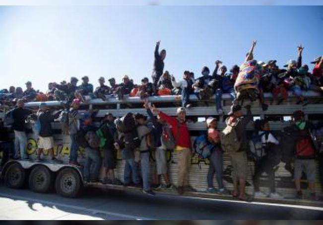 La caravana de migrantes hondureños, a quienes en Guatemala y México se sumaron otros centroamericanos, salió de su país el 13 de octubre de 2018. EFE/Archivo