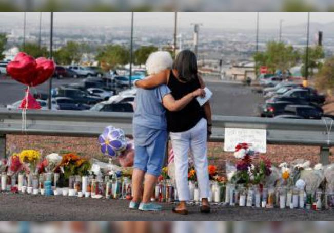 Emma Del Valle (L) hugs Brenda Castaneda (R) while attending the make shift memorial along the street after the mass shooting that happened at a Walmart in El Paso, Texas, USA, 05 August 2019. EFE/EPA/Larry W. Smith