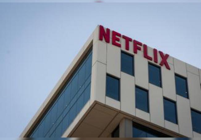 A Netflix logo hangs on the company's headquarters in Los Angeles, California, USA. EFE/EPA/Christian Monterrosa