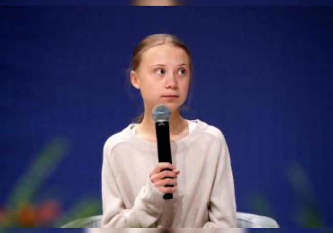 La joven activista medioambiental sueca Greta Thunberg (c), da un discurso durante su participación en un encuentro con científicos. EFE/Zipi/Archivo